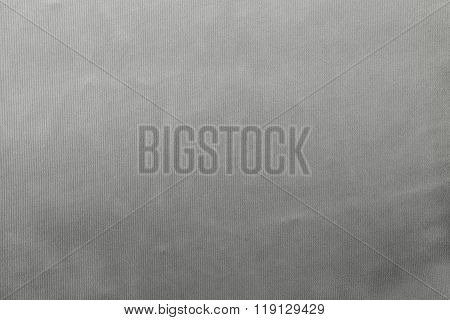 Grained Textured Background From Fabric Of Pale Gray Monochrome Color