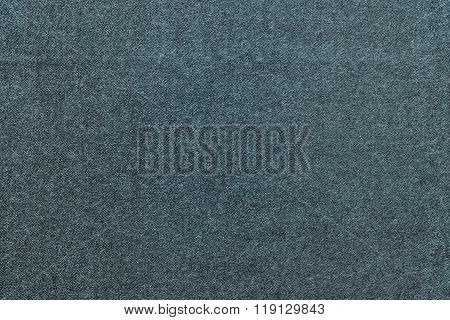 Speckled Textured Monochrome Background From Fabric Of Dark Turquoise Color