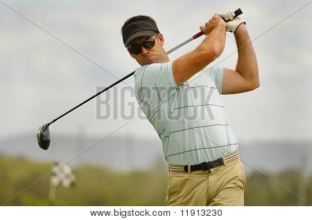 Golfer Takes Driver And Tees Off