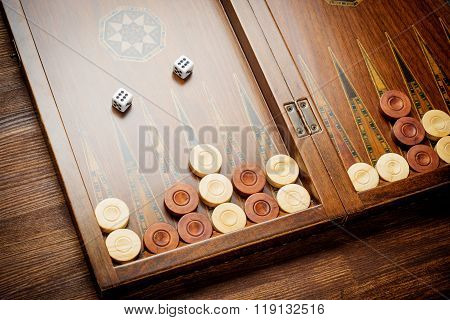 Color detail of a Backgammon game with two dice close up