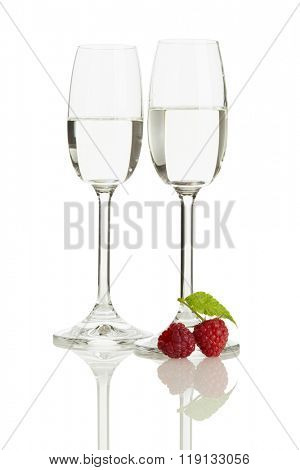 two glasses of german raspberry schnaps isolated on white background