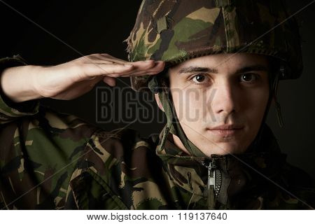 Portrait Of Soldier In Uniform Saluting