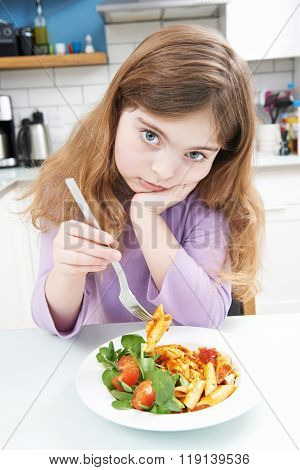 Portrait Of Girl Not Enjoying Healthy Meal At Home