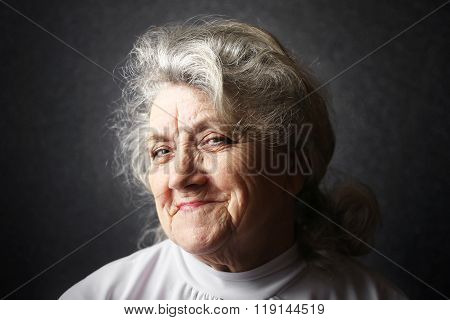 Cunning and thinking granny portrait