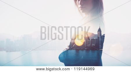 Closeup of businesswoman. Double exposure, city and bay on the background. Blurred background, horiz