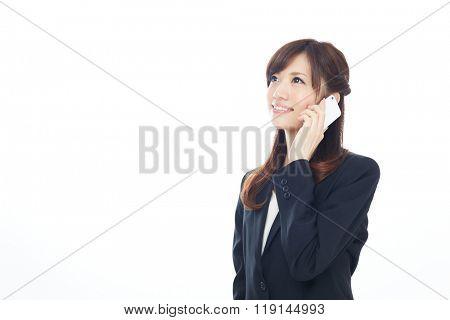 Beautiful asian business woman using a cellular phone