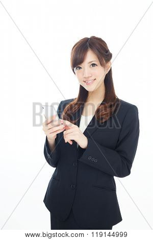 Beautiful asian business woman using a cellular phone