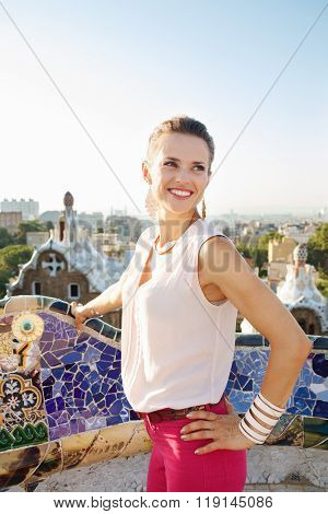 Woman Tourist In Park Guell, Barcelona Looking Into Distance