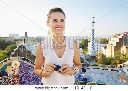 Woman Tourist With Photo Camera In Park Guell, Barcelona, Spain