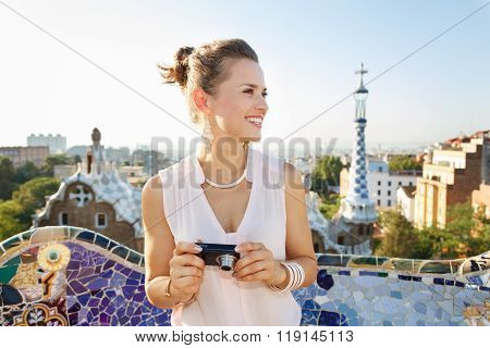 Woman Tourist With Photo Camera Looking Aside In Park Guell