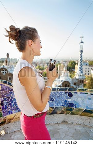 Seen From Behind Woman Tourist With Photo Camera In Park Guell