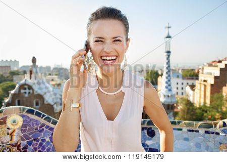 Smiling Woman Talking Smartphone While In Park Guell, Barcelona