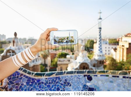 Closeup On Female Tourist Taking Photos In Park Guell, Barcelona