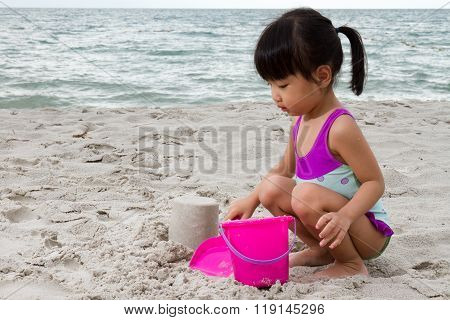 Asian Little Chinese Girl Playing Sand With Beach Toys