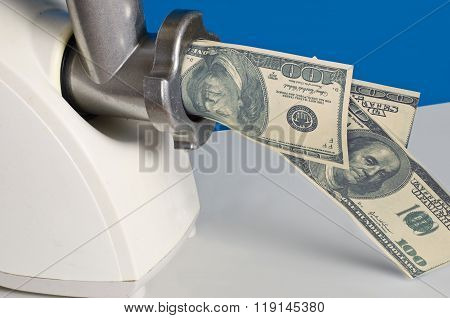 Dollars In A Meat Grinder