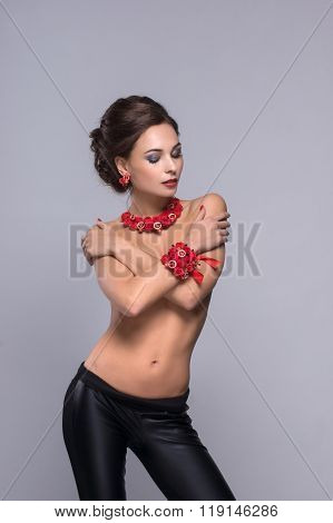 Luxury portrait of beautiful girl with red decorations