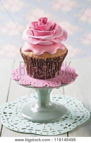 Cupcake with rose flowers on a stand