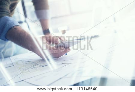Business concept, businessman making photo smartphone. Architectural project on the table. Horizonta