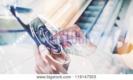 Photo of female hands touching screen Of tablet. Visual interfaces effects. Blurred background, mock