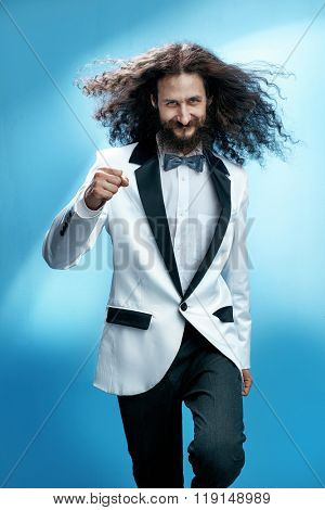 Funny and siknny man wearing tuxedo