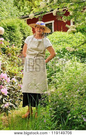 Senior Woman Standing In Garden