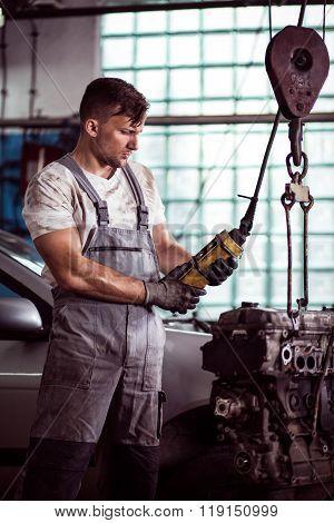 Automotive Technician Repairing Engine