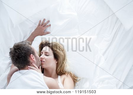 Man Kissing Girlfriend