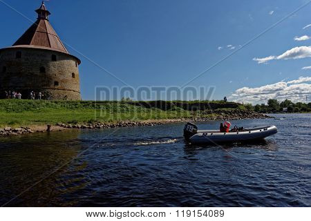 ORESHEK FORTRESS, LENINGRAD OBLAST, RUSSIA - AUGUST 15, 2015: Boat participating in River marathon Oreshek Fortress race. This international motorboat competitions is held since 2003