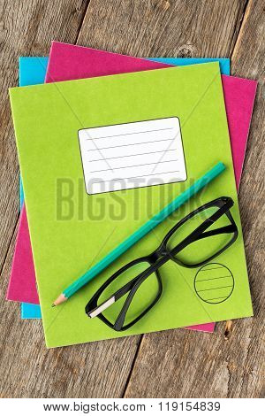 Colored Exercise Books,pencil And Glasses