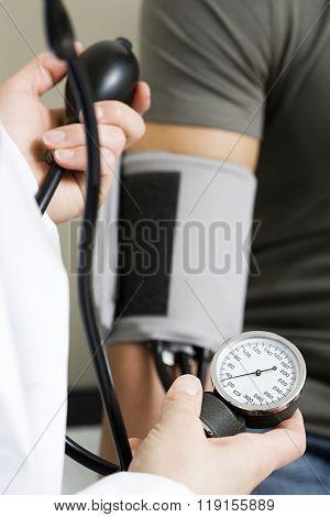 Taking blood pressure reading