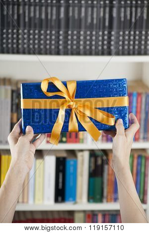 Showing Blue Gift Box Over Library