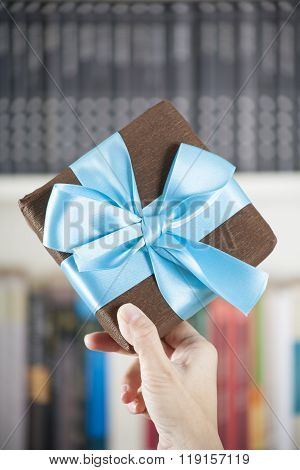 Showing Brown Present Box Over Library
