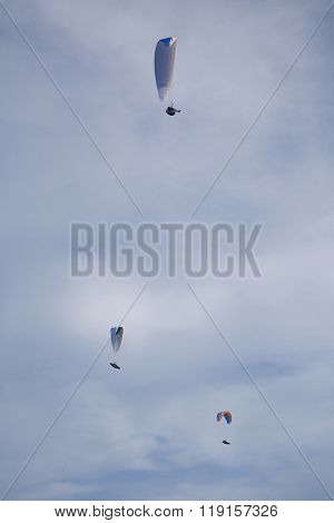Three Paragliders In The Sky