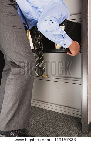 Businessman with his head in a drawer