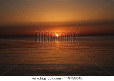 Sunrise Over Sea With Boat