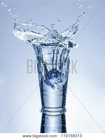 Icecube Splashing Into A Glass Of Water