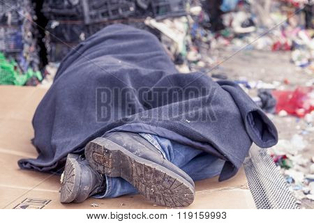 Homeless Man Sleeps In The Waste On A Wire Mesh Of Bed