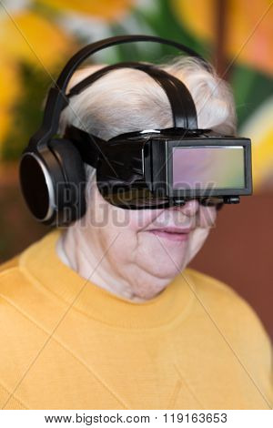 Senior Adult With Virtual Reality Glasses