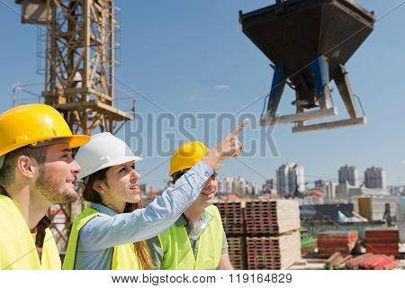 Architect With Construction Workers