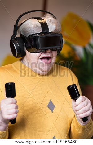 Elderly Woman With Gaming Simulator