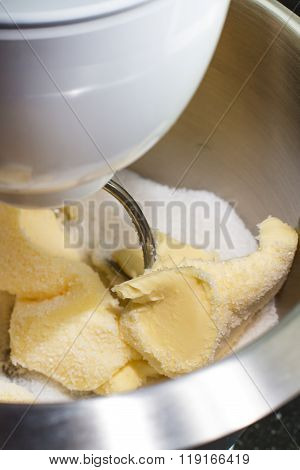 Mixing butter and sugar with mixing machine, homemade bakery