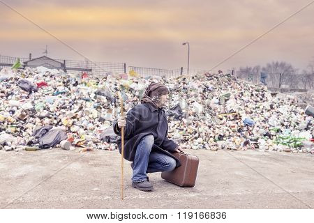Homeless With Suitcase Lives In Landfill