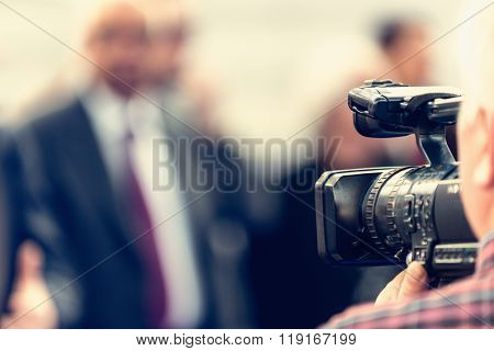Cameraman Recording Conference