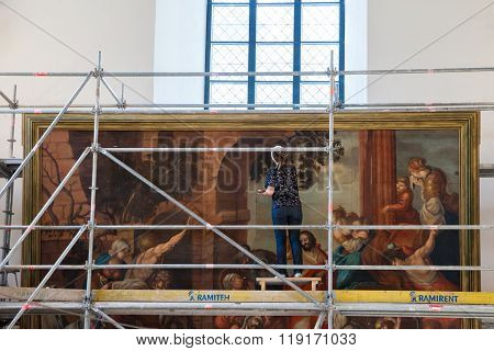 Riga, Latvia - 25-august-2015: Professional Restorer Working At An Ancient Paintings Representing Re