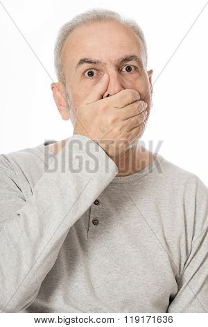 Portrait Of A Old Man Covering His Mouth Over White Background