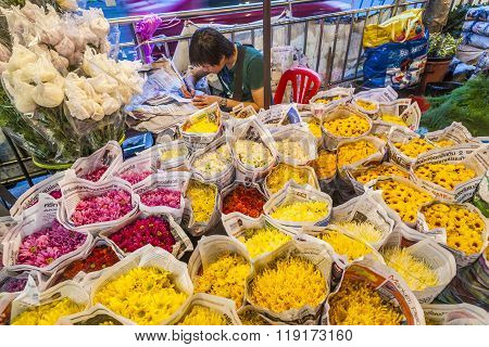 Man Sells Colorful Flowers At The Flowermarket In Bangkok Early Morning