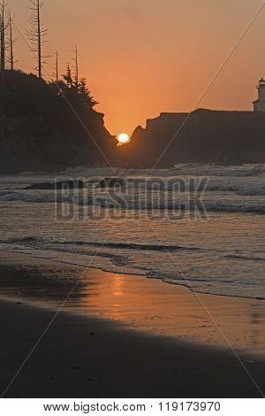 Sunset Between The Rocks On An Ocean Coast