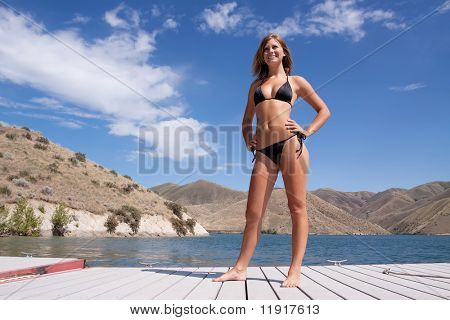 Sexy woman wearing a bikini by the lake