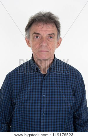 Closeup Portrait Of A Serious Middle-aged Man Looking Directly Into The Camera Standing Outdoors Amo