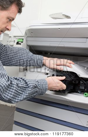 Shot Male Technician Repairing Digital Photocopier Machine